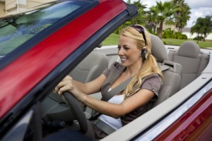 http://www.dreamstime.com/stock-photo-woman-convertible-car-bluetooth-headset-image11559370